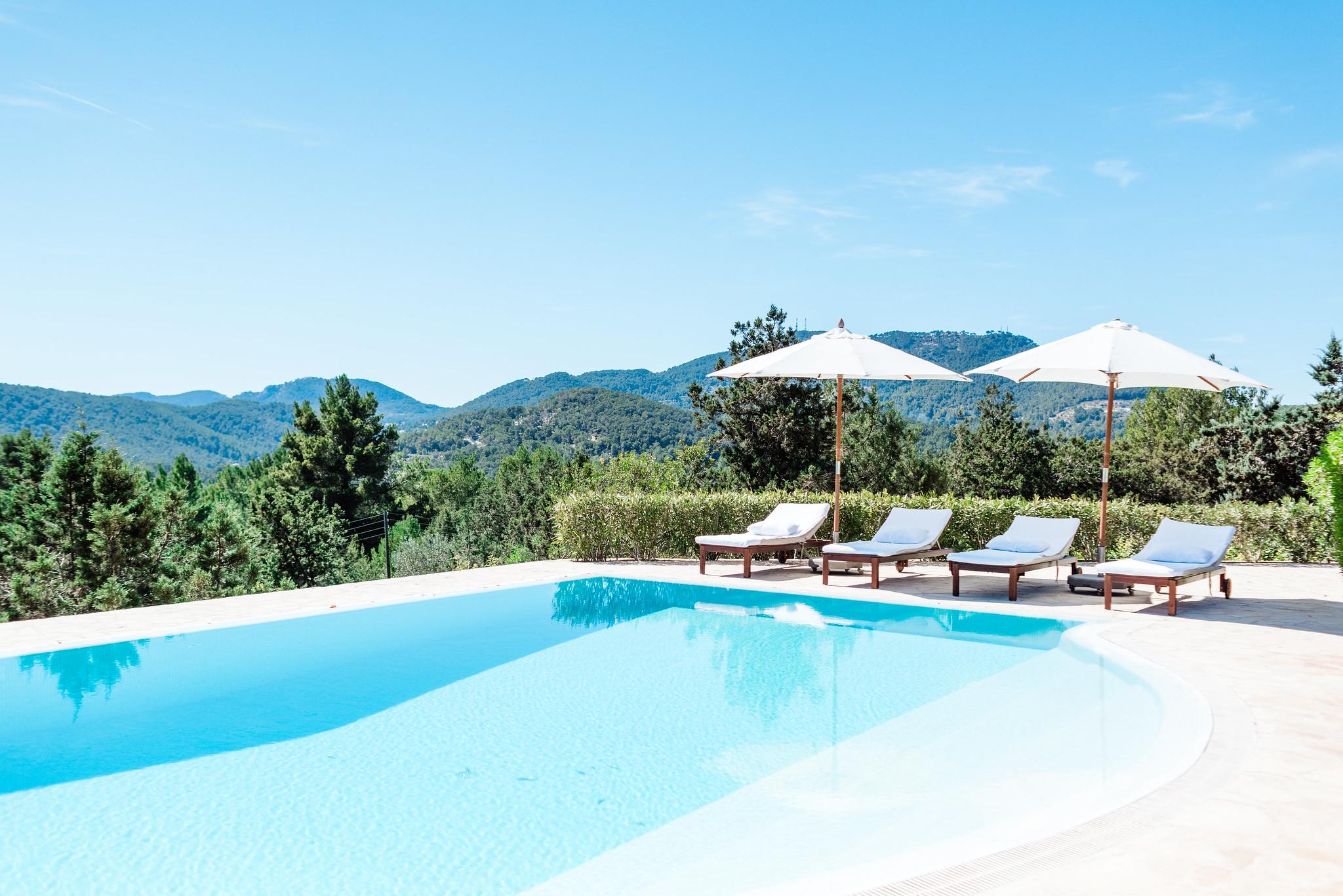 https://www.white-ibiza.com/wp-content/uploads/2020/06/white-ibiza-villas-villa-andrea-exterior-pool-shot.jpg